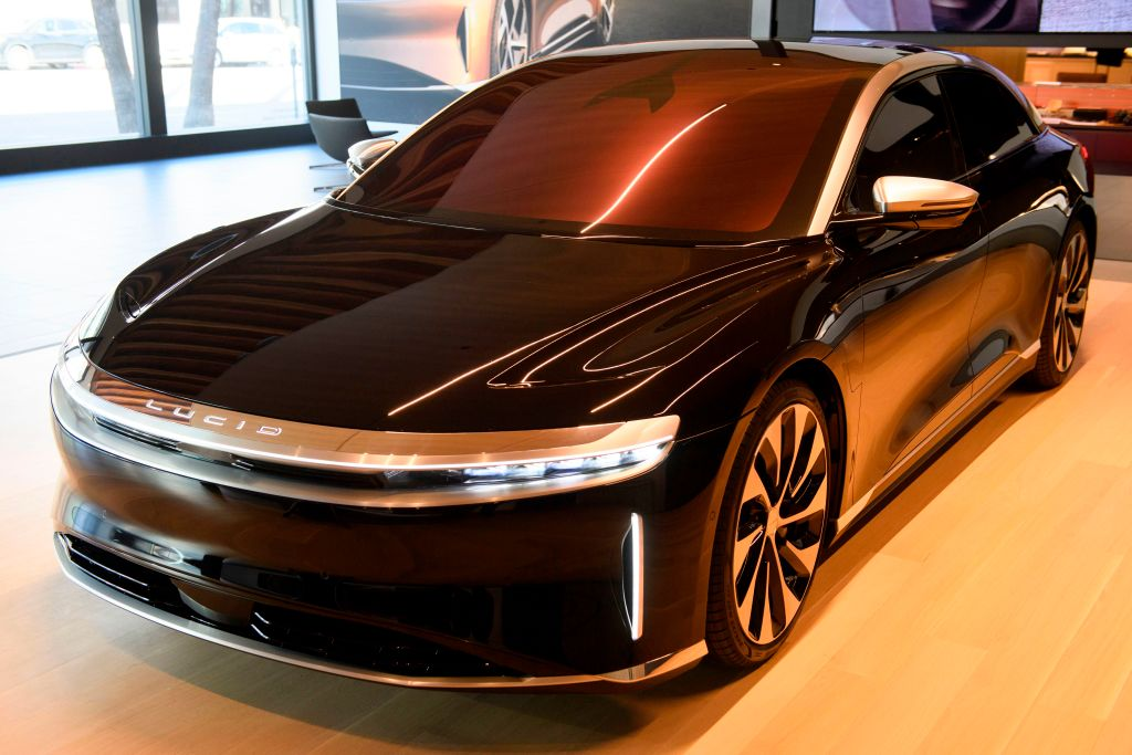 A black Lucid Air Grand Touring luxury electric sedan on display