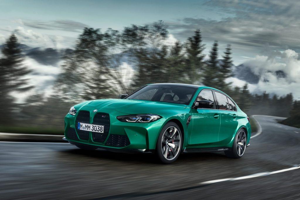 An emerald green BMW M3 action shot