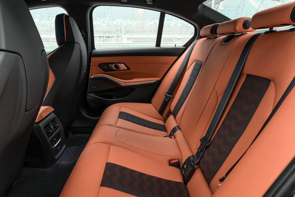 The orange leather interior of the back seats of the 2021 BMW M3
