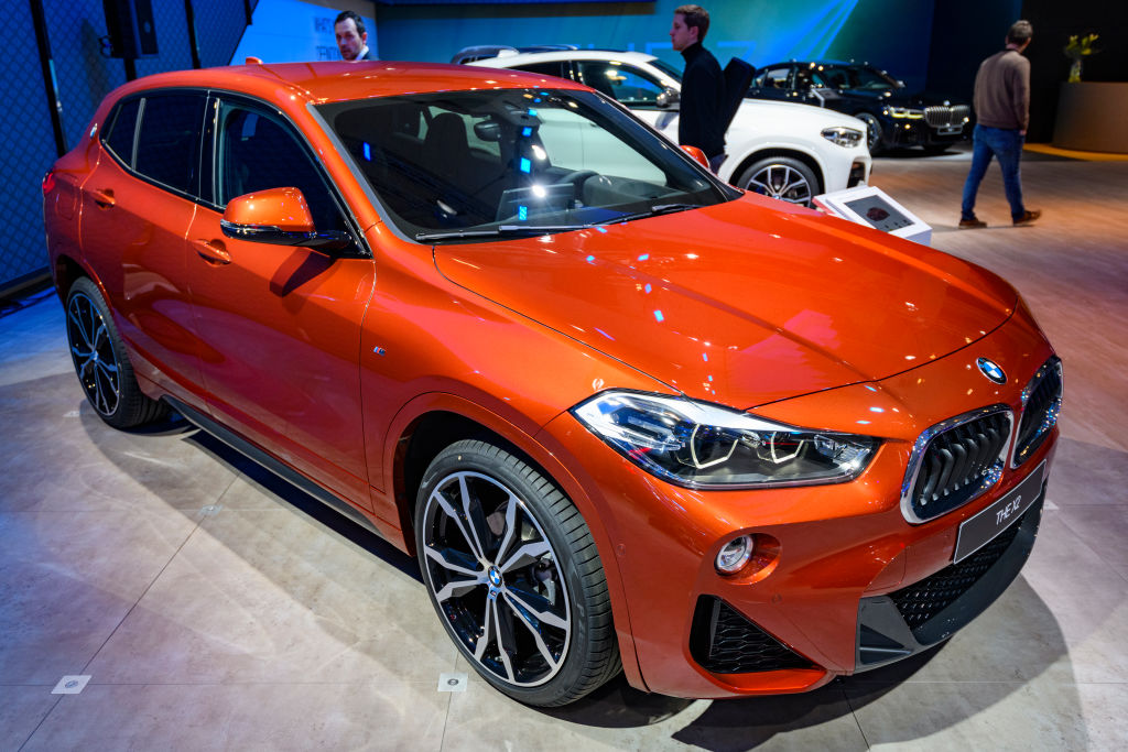 An orange BMW X2 on display