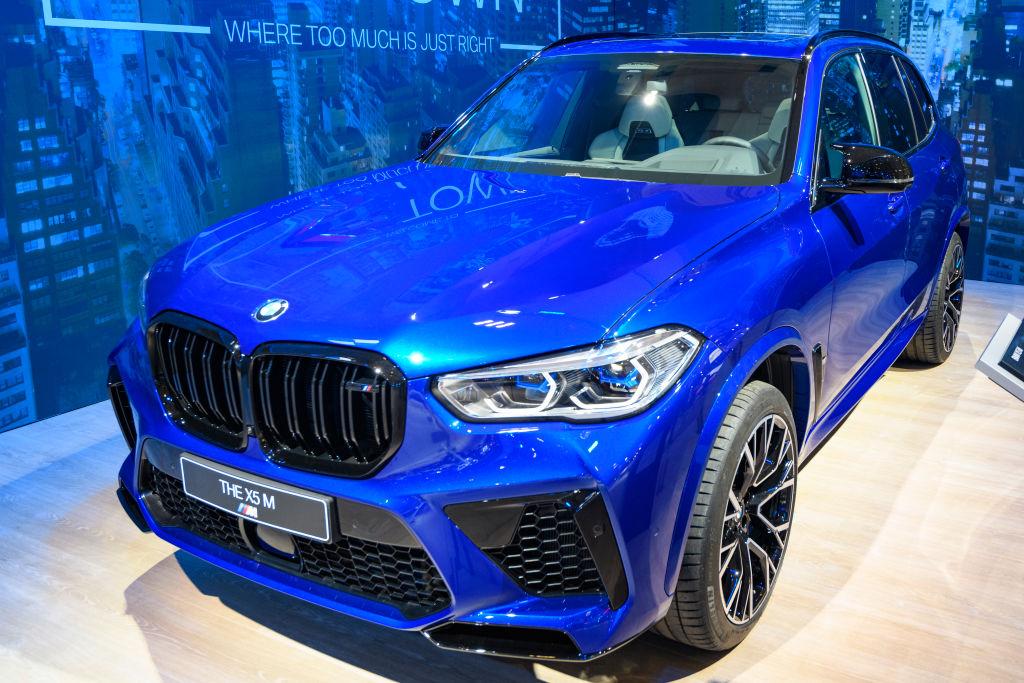 A blue BMW X5 M on display