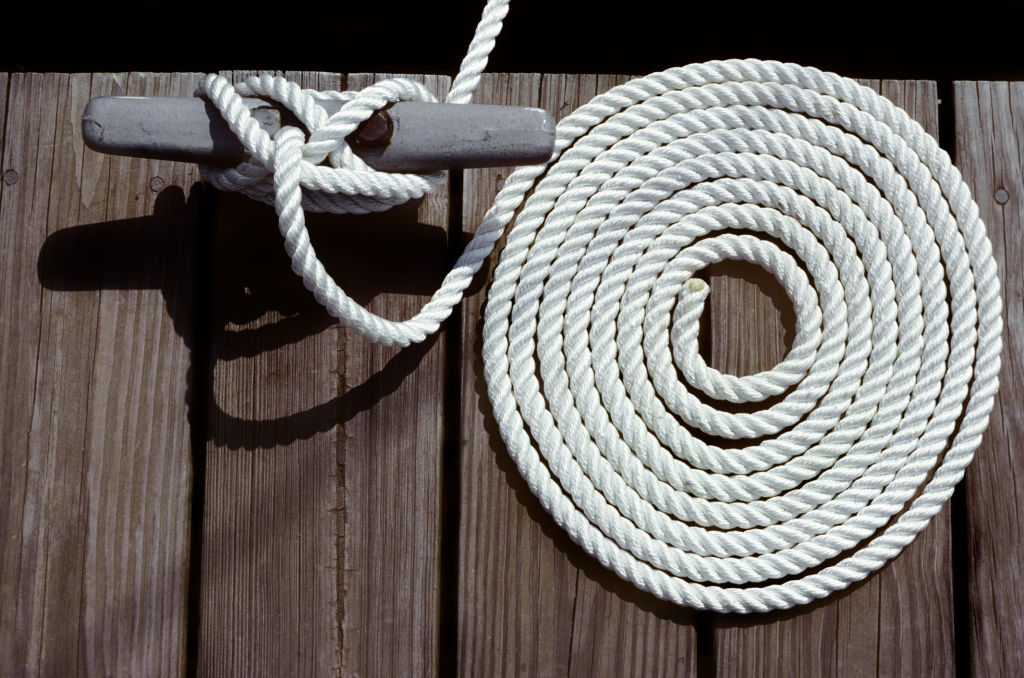 Two of the most basic boating accessories, a coil of rope and a tie-off