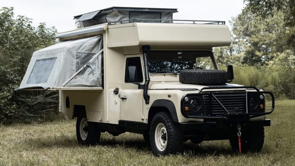 1990 Land Rover Defender 130 dream RV camper-truck conversion parked in a field
