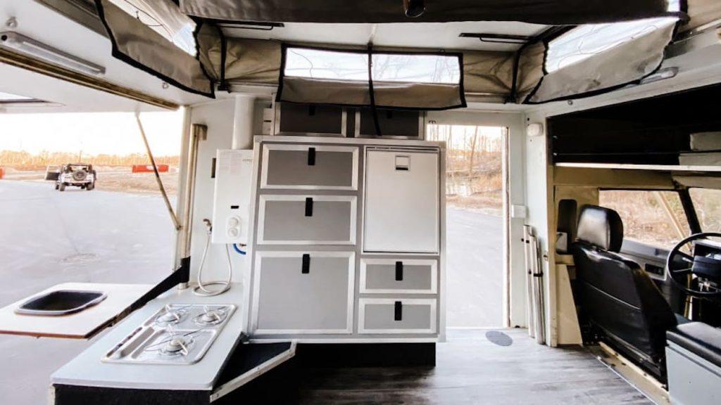rear hatch of a 1990 Land Rover Defender camper opened up