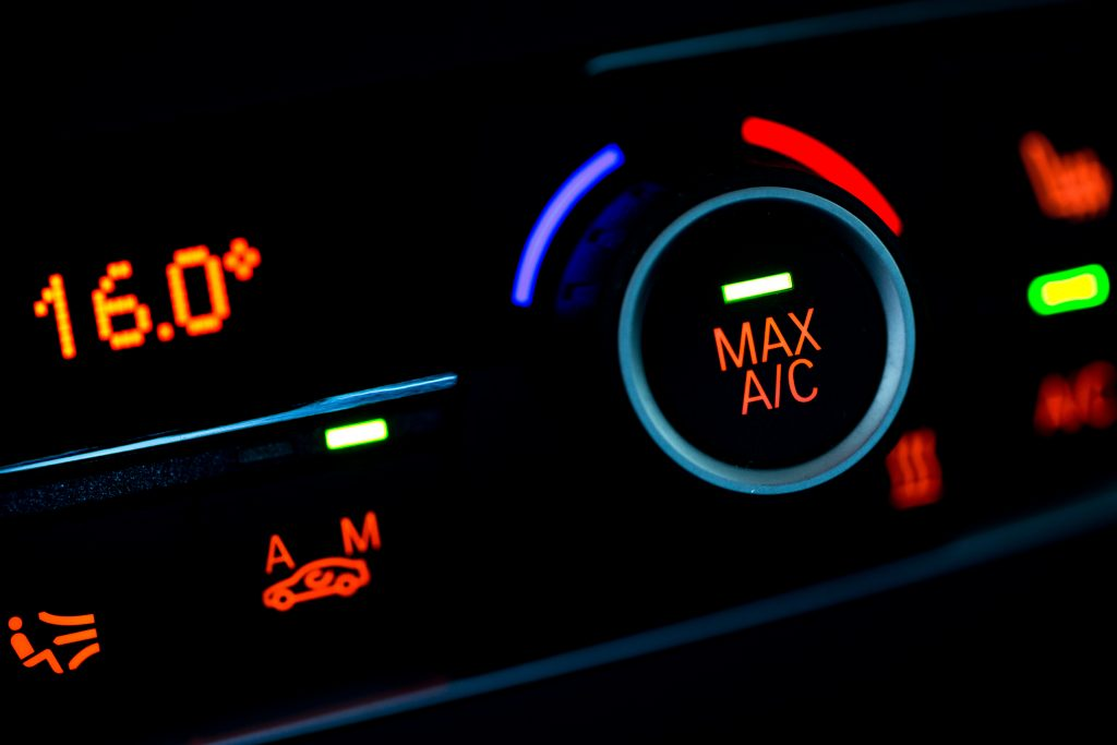 A photo of a car's air conditioner set to maximum cooling.