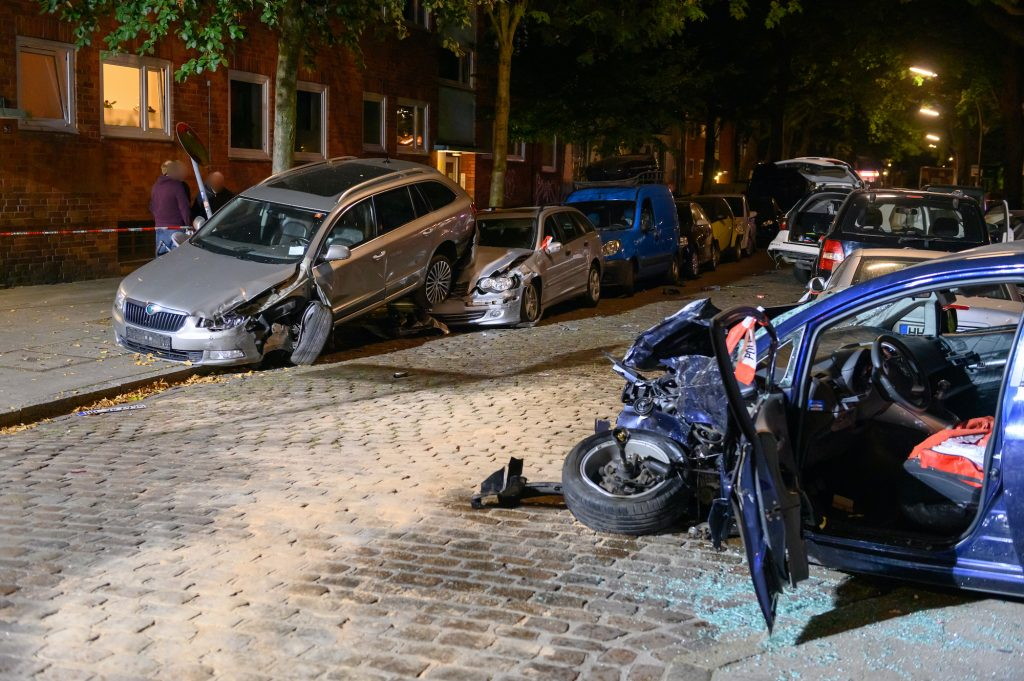 A car accident shows several wrecked cars