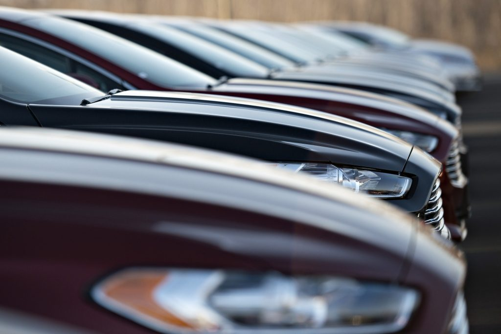 A row of 2014 Ford Fusion vehicles sit on a car sales lot at Uftring Ford in East Peoria, Illinois, on Saturday, November 30, 2013