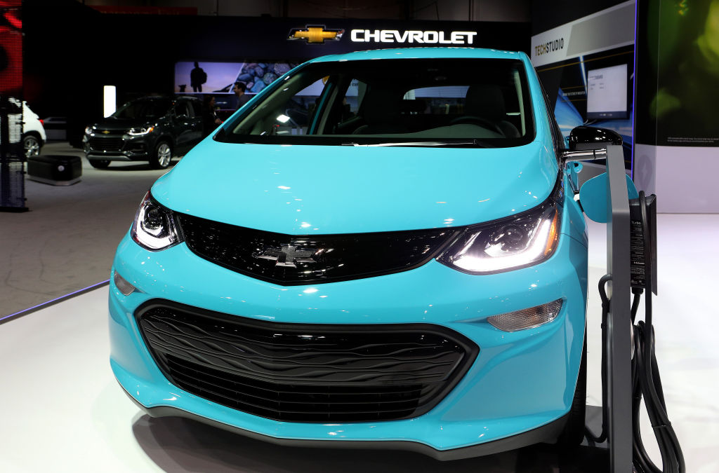 A bright blue 2020 Chevrolet Bolt EV on display