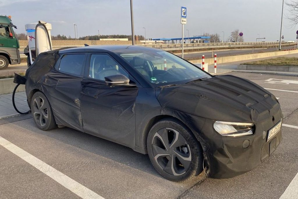 """shrouded Kia """"CV"""" that has yet to be released is siad to rival the Porsche Taycan"""