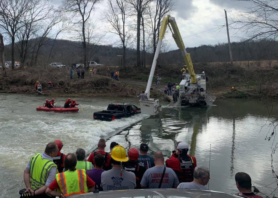 First responders rescuing family from Ram 1500 Classic in floodwater