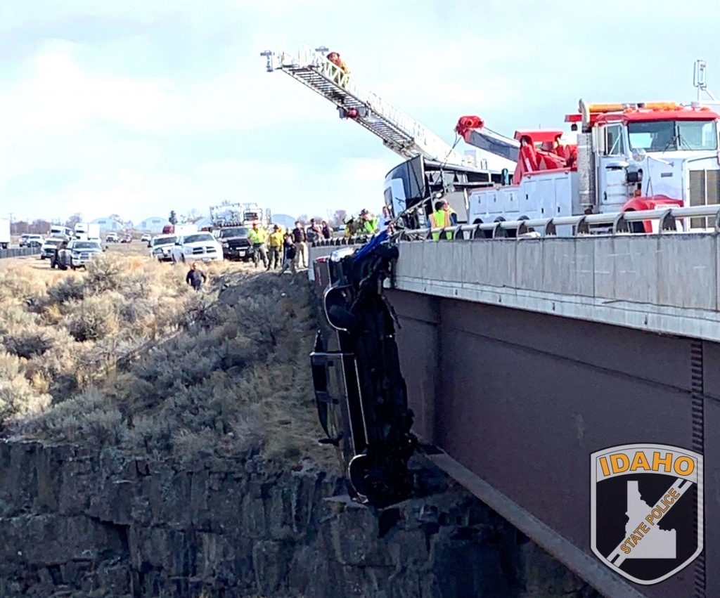 Ford F-350 dangling over bridge