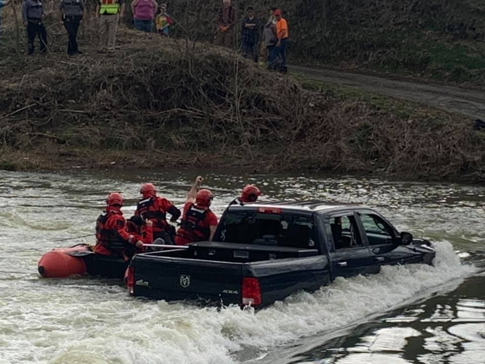 Family being rescued from Ram 1500 Classic in floodwater