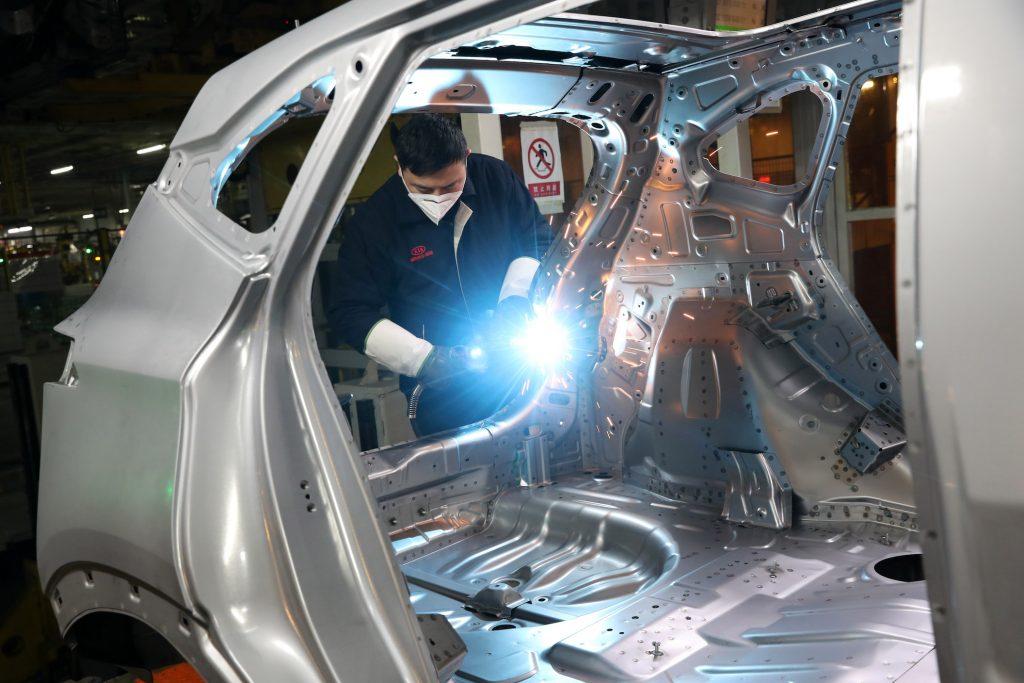 man working in Kia Factory in China