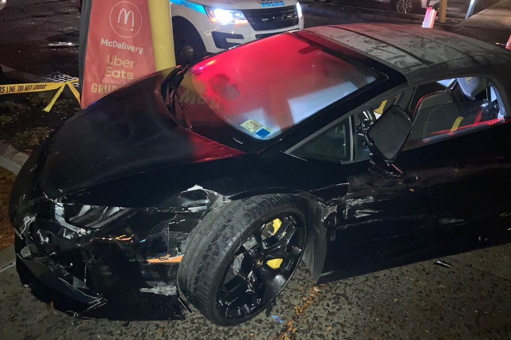 An image of a crashed Lamborghini Huracán Spyder outside of McDonald's.