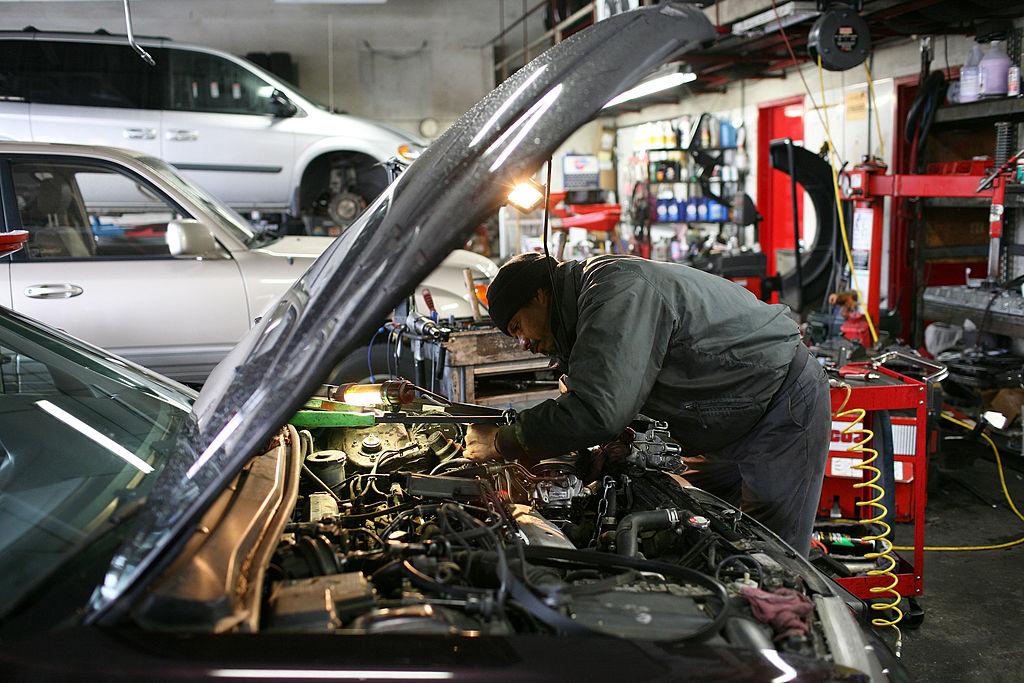 A mechanic works on a car at San Rafael Firestone in San Rafael, California.