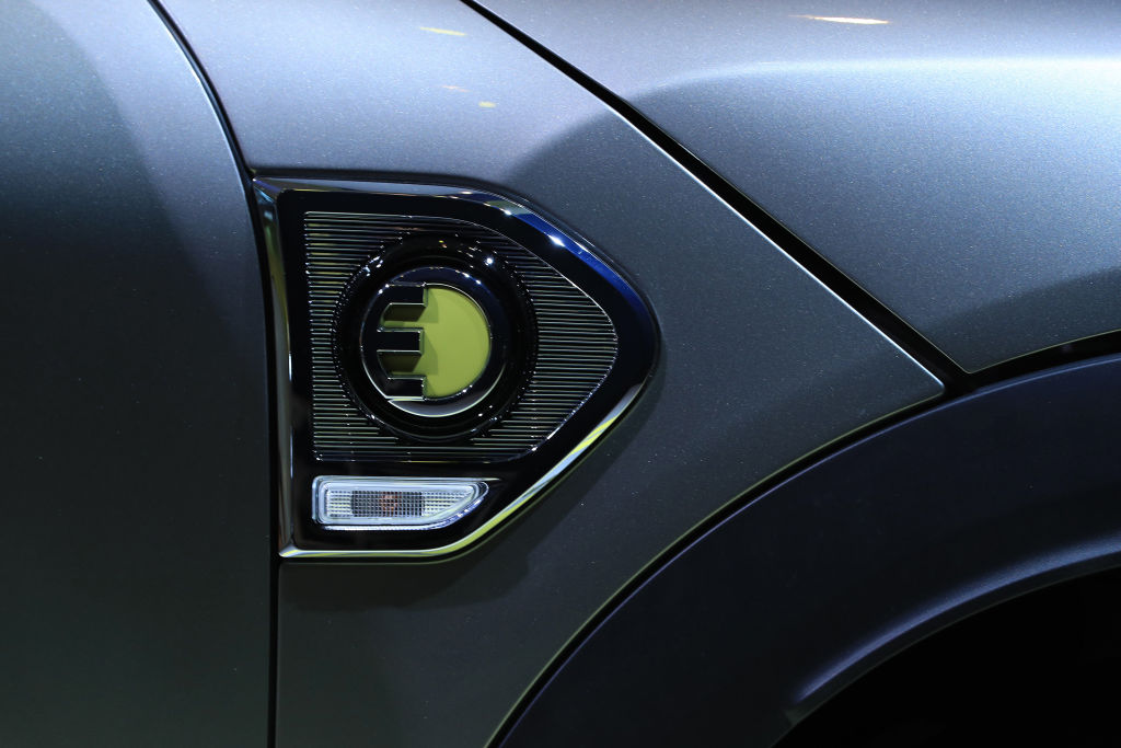 A close up of the electric logo on the new Mini Cooper