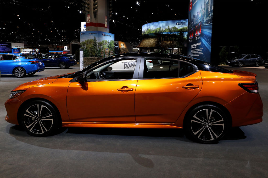 An orange 2020 Nissan Sentra on display from the side