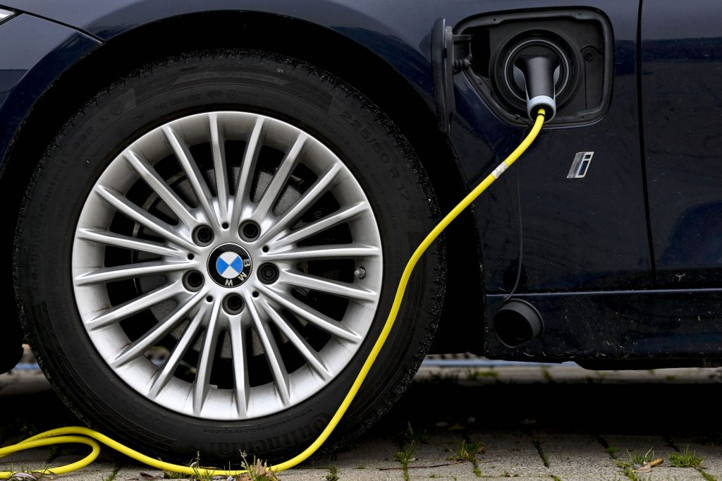 A plug-in hybrid BMW car with an electricity charger
