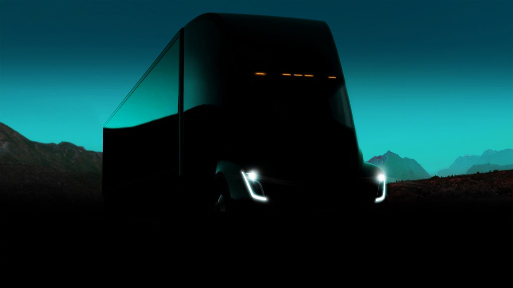 A dark figure sneak peak of the Tesla Semi with only the headlights visible