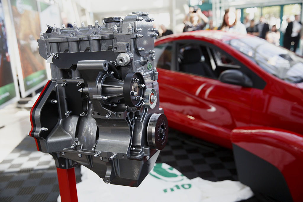 A three-cylinder engine on display at an auto show