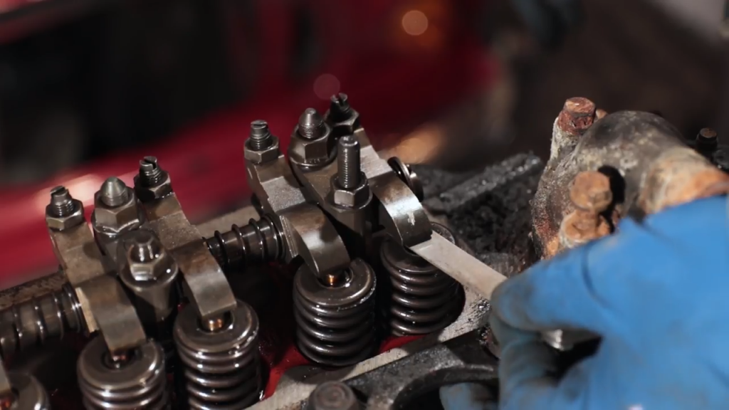 A valve adjustment being performed on a cylinder head