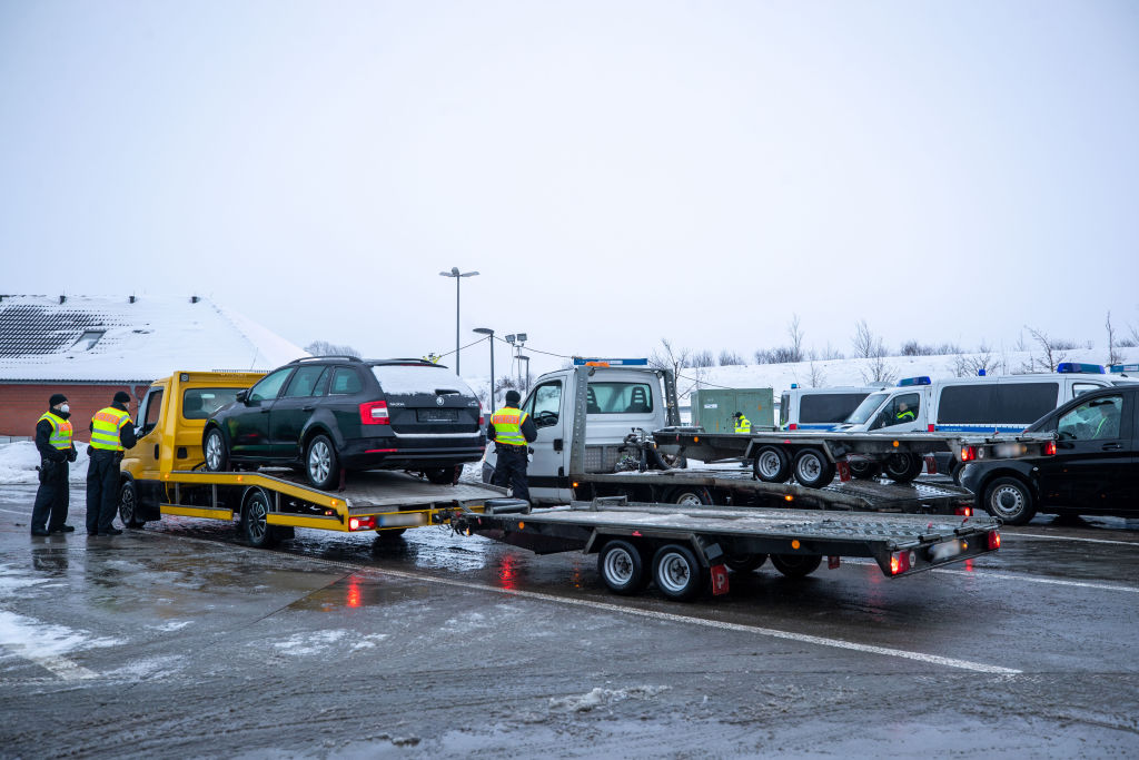 Vehicles being loaded onto a towing vehicle