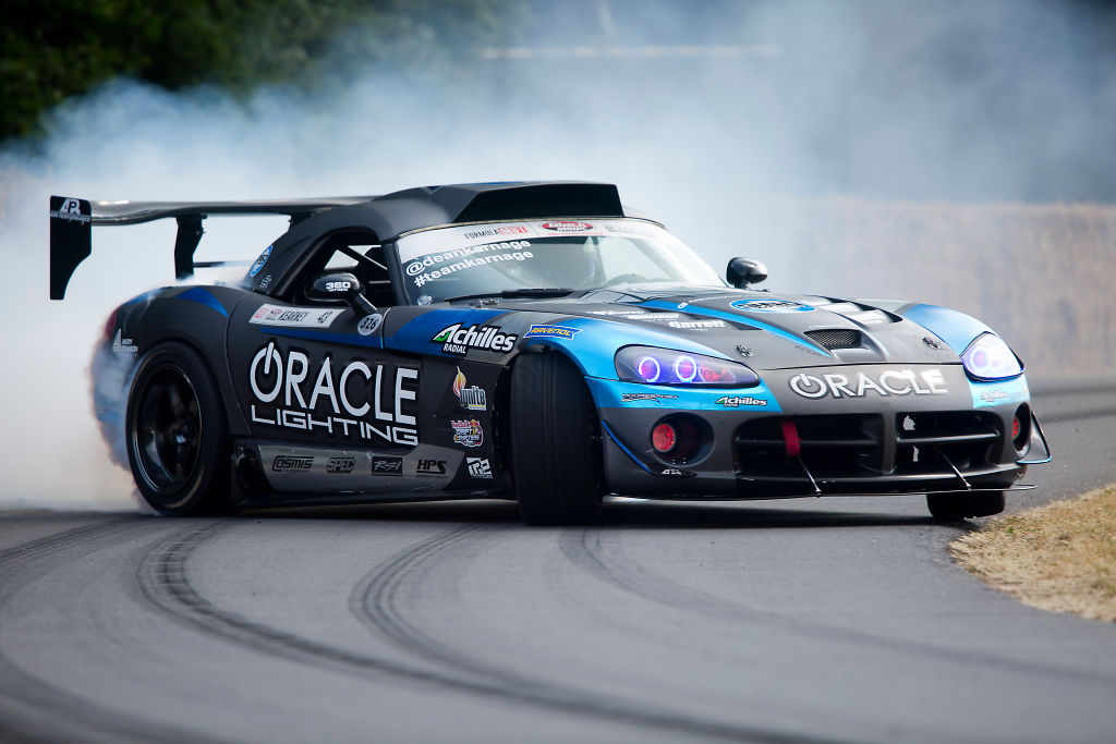 A track edition dodge viper takes a hard corner at the track