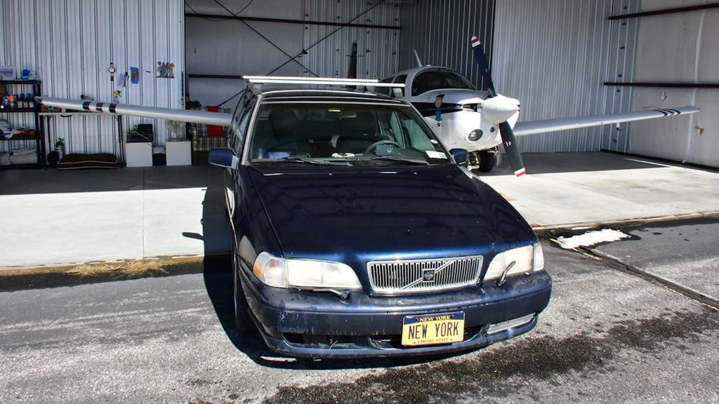 "This blue Volvo station wagon is the most expensive volvo ever due to its ""New York"" vanity plate"