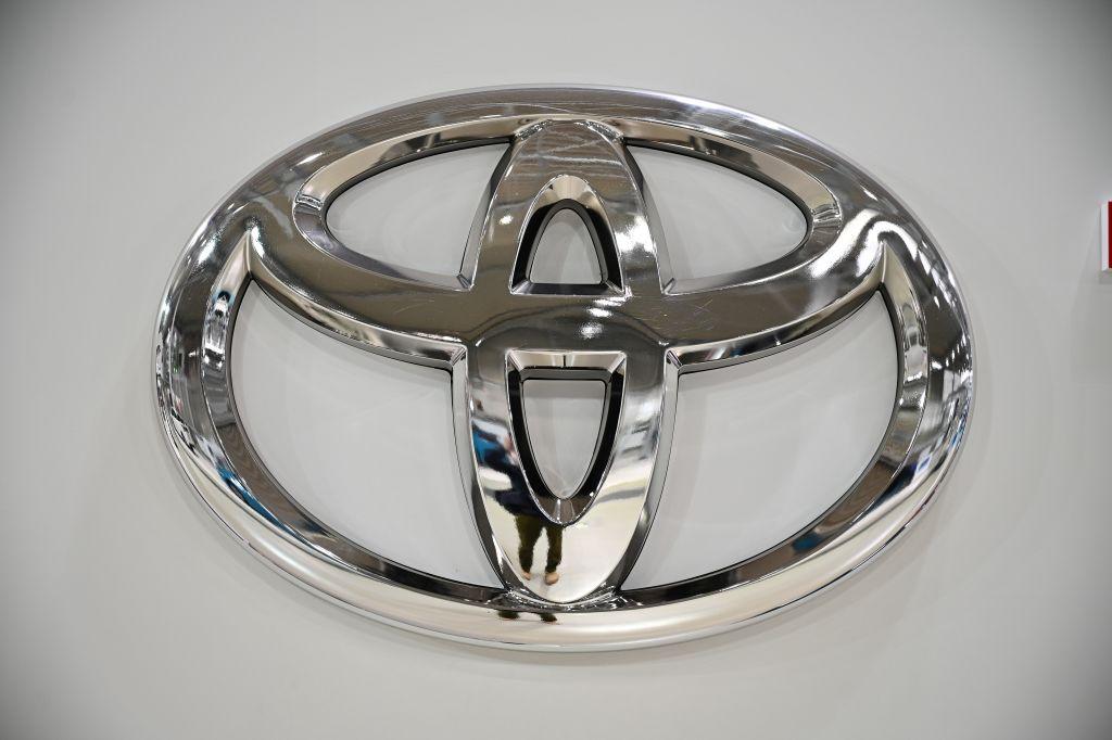 Chrome Toyota emblem on a white vehicle