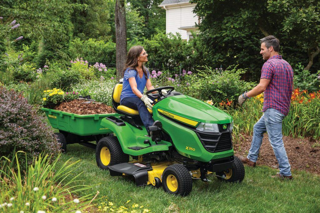 Woman using a 2021 John Deere X300 Lawn Tractor