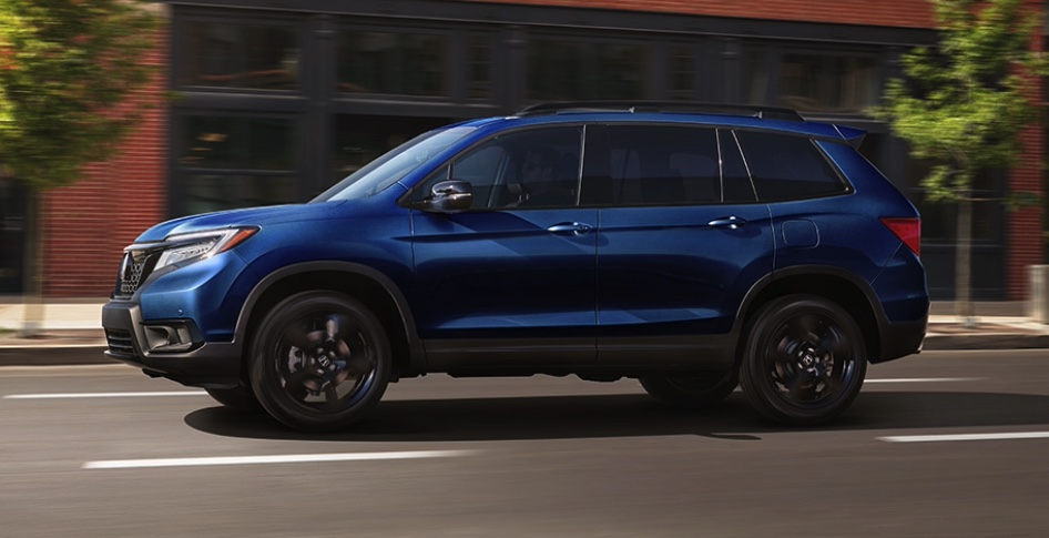 a blue model of this crossover driving in the city