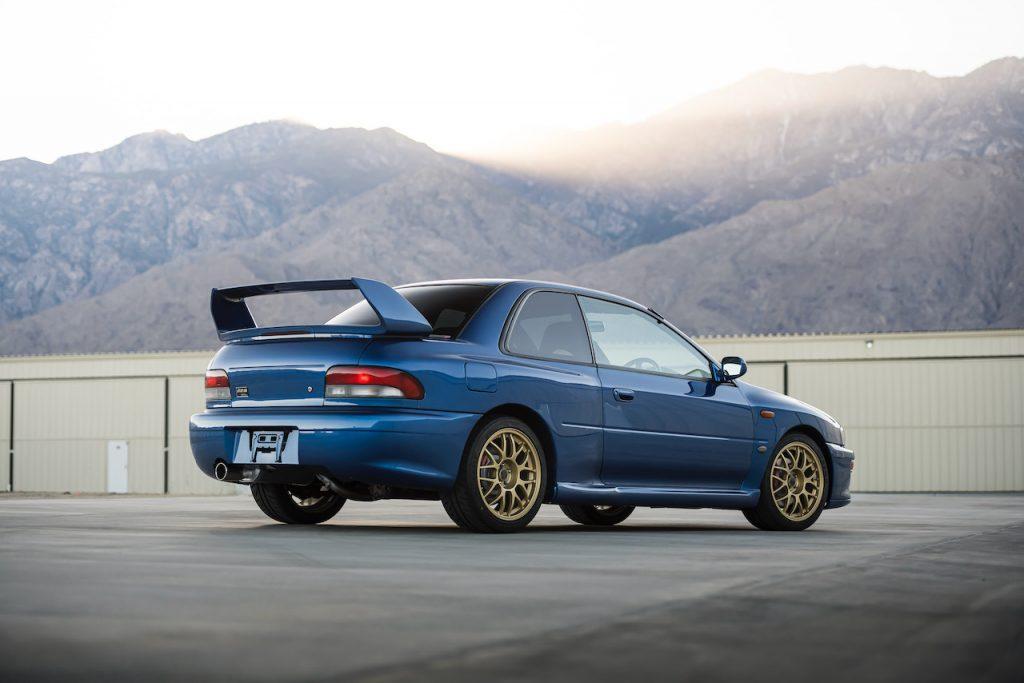 An image of a blue Subaru Impreza 22B STi parked outdoors.