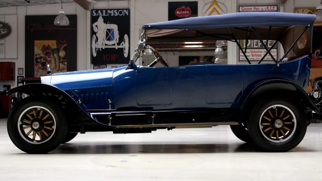 The side view of a blue 1916 Owen Magnetic