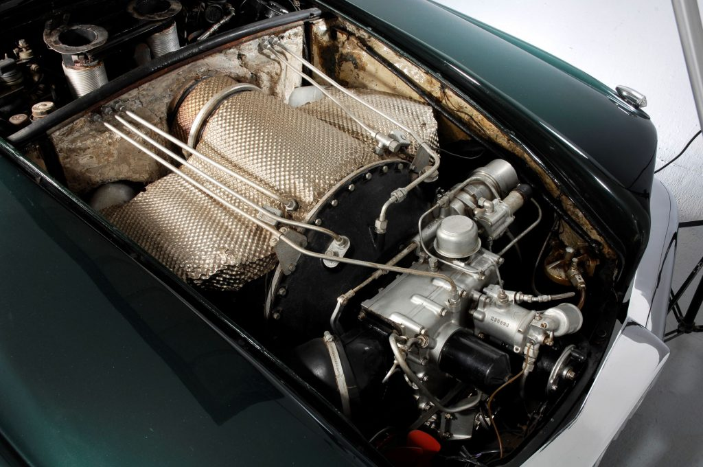 The gas turbine engine under the hood of a green 1961 Rover T4