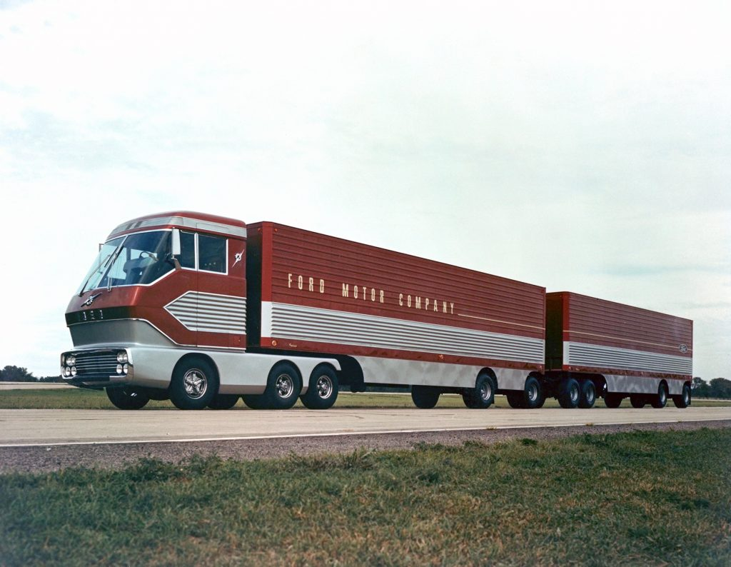 The red-and-silver 1964 Ford 'Big Red' gas turbine truck driving down a highway