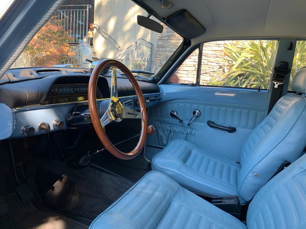 The blue-leather-upholstered front seats and dashboard of a 1967 Volvo Amazon 122S