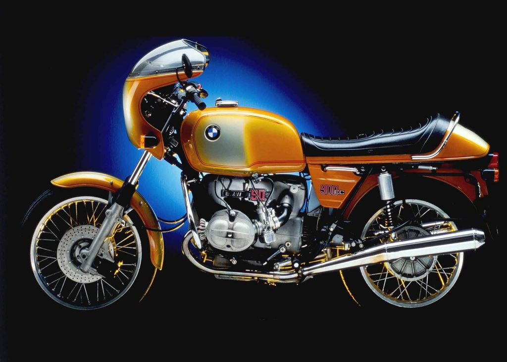 The side view of an orange-and-silver 1973 BMW R90S