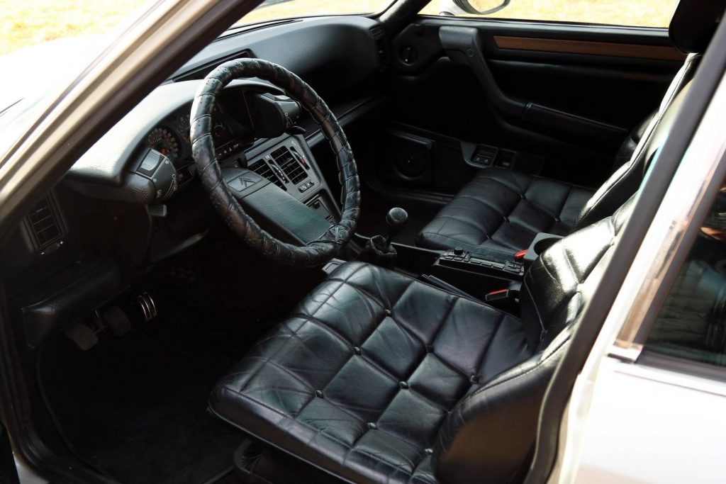 The black-leather-upholstered front seats and dashboard of a 1986 Citroen CX 25 Prestige Turbo