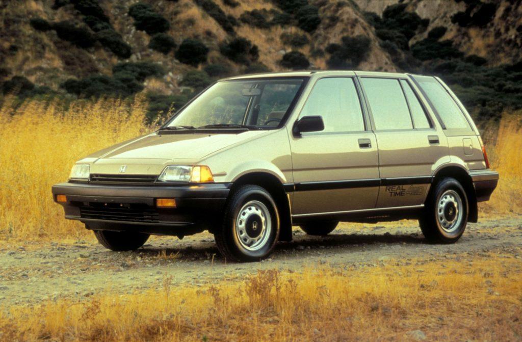 A tan 1987 Honda Civic 4WD Wagon in a grassy field