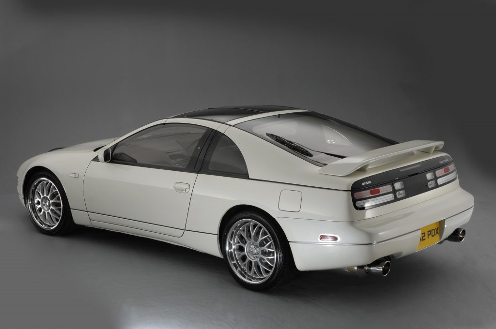 A white 1990 Nissan 200ZX coupe on display