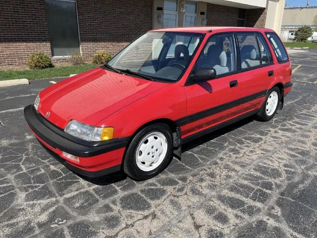 A red 1991 Honda Civic 4WD Wagon in a parking lot
