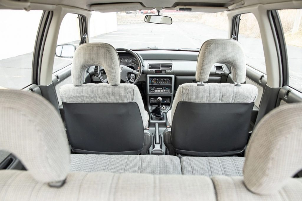 The gray-cloth interior of a 1991 Honda Civic 4WD Wagon seen from the rear hatch