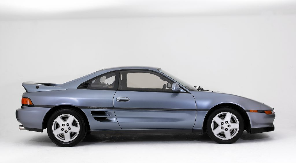 A silver Toyota MR2 coupe on display