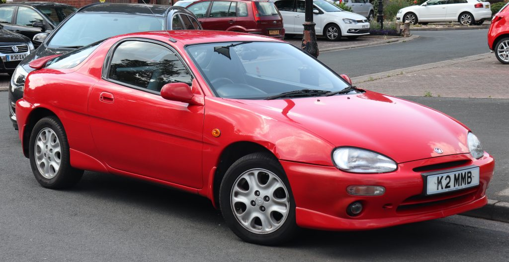 a red 1992 Mazda MX-3 shown from the front