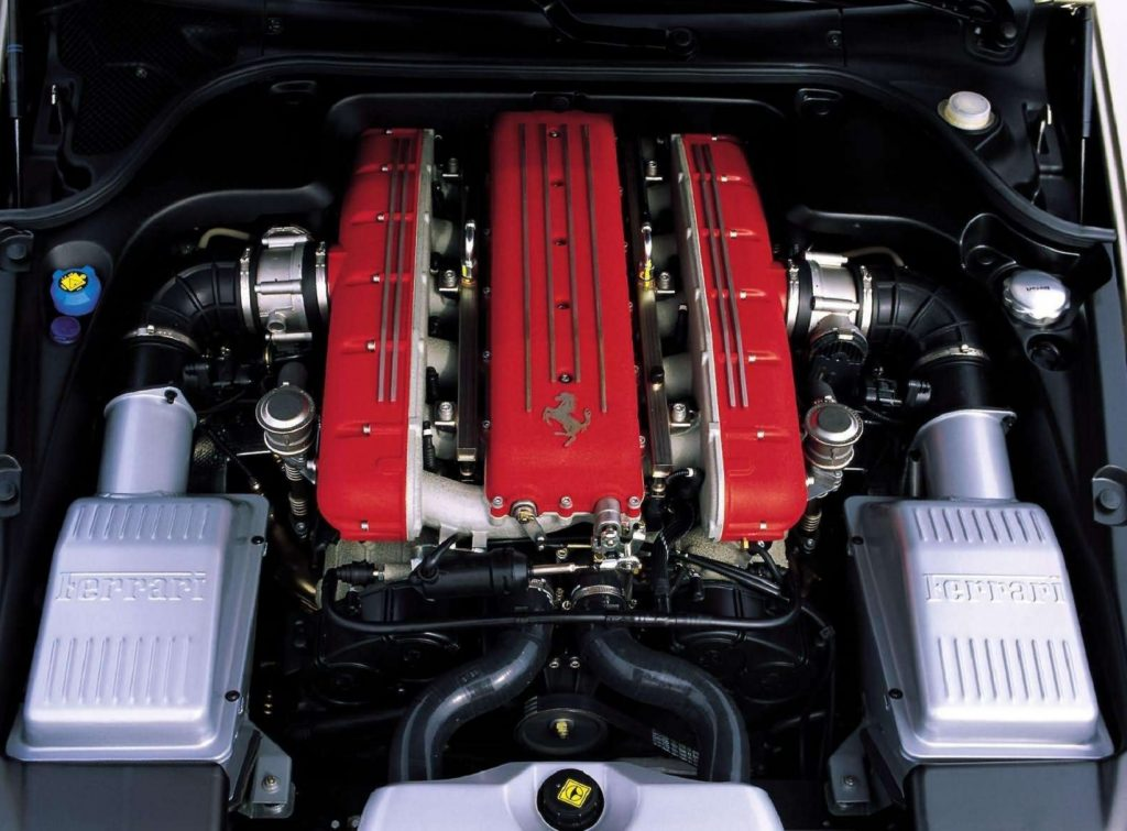 The red-covered 5.7-liter V12 in the engine bay of a 2004 Ferrari 612 Scaglietti