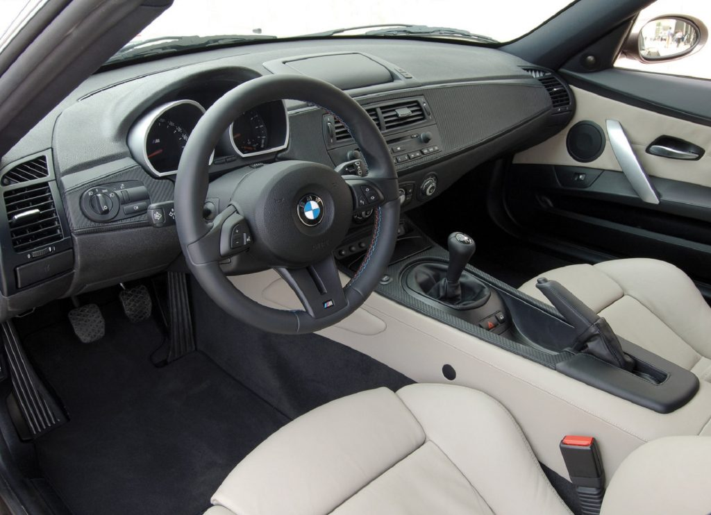 The white-leather-upholstered seats and carbon-fiber-trimmed dashboard of a 2006 BMW Z4 M Coupe