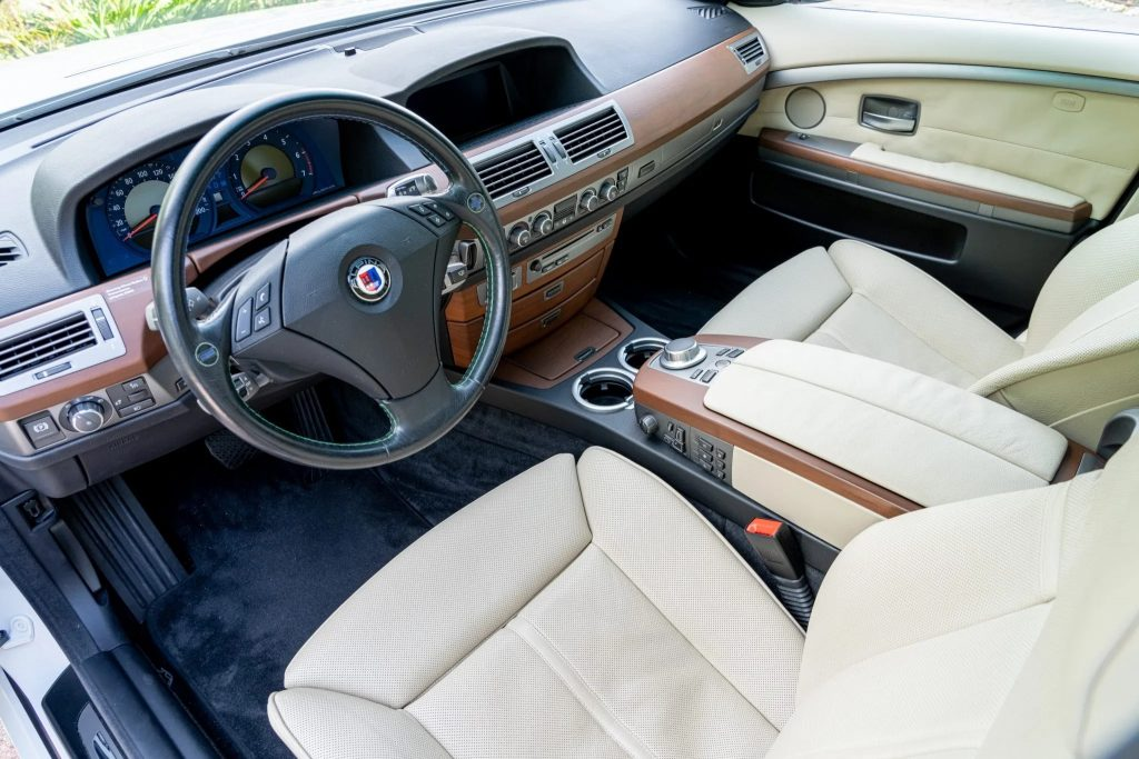 The white-leather-upholstered front seats and brown-wood-trimmed dash of a 2007 BMW Alpina B7