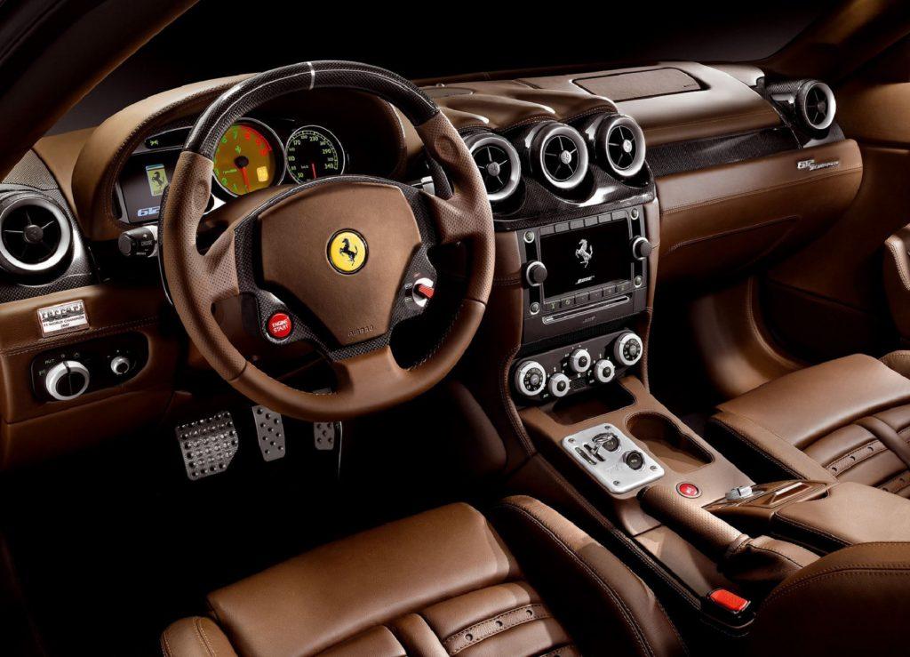 The brown-leather-and-carbon-fiber front interior of a 2009 Ferrari 612 Scaglietti