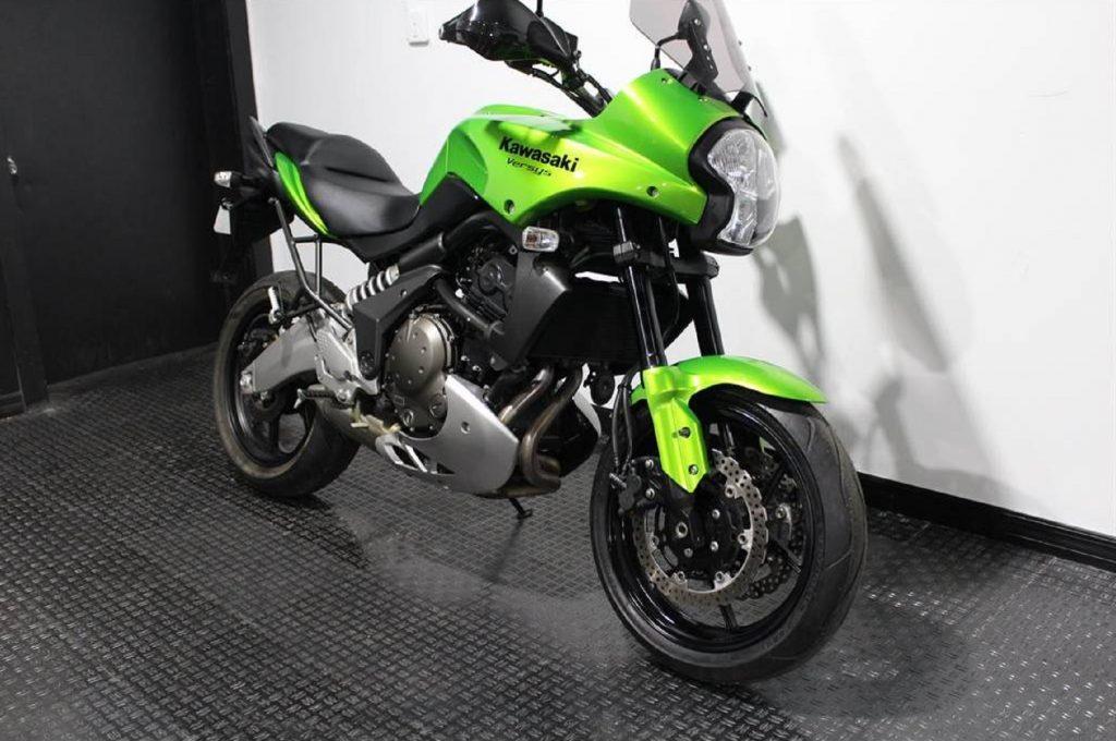 A green 2009 Kawasaki Versys 650