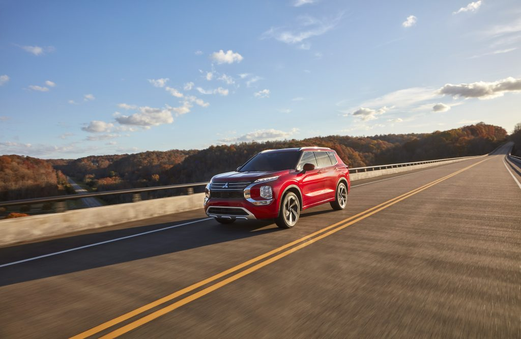 The 2022 Mitsubishi Outlander in red driving down the road. Consumer Reports is currently testing this model